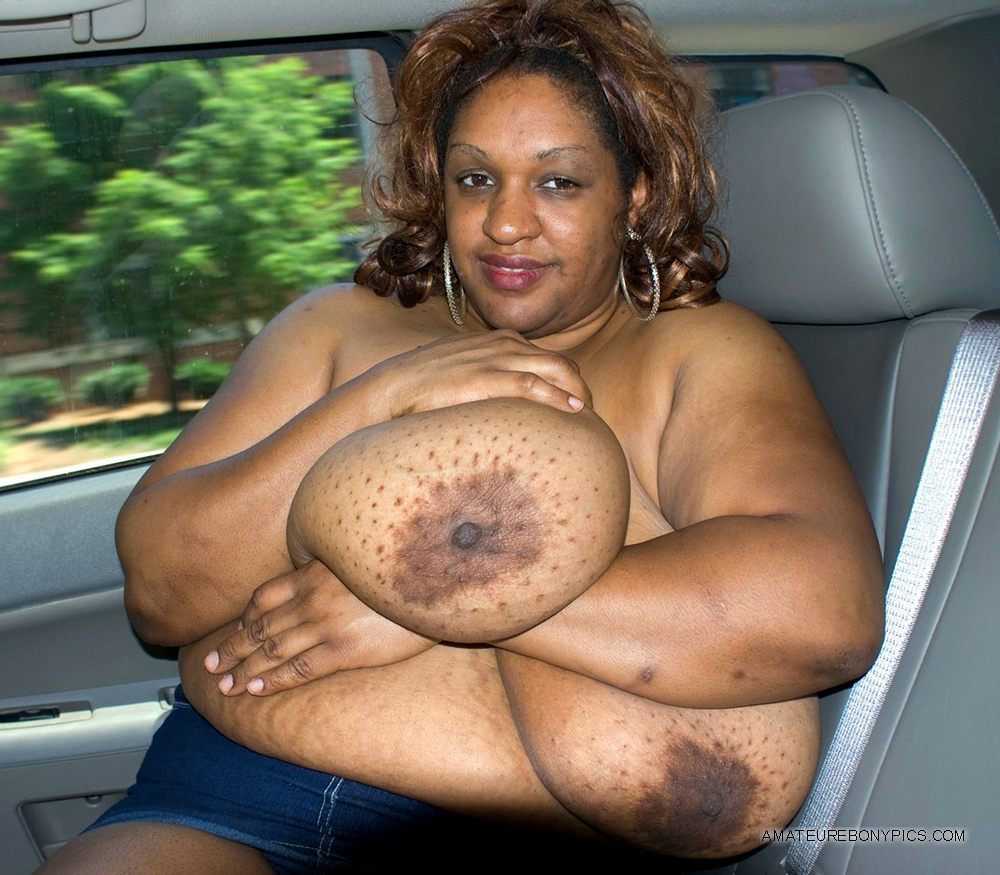 Chubby black mommy Dlysha squeezing her boobs... Picture #1